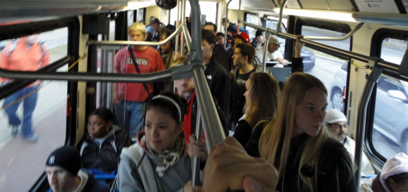 an interior photo of a bus full of young riders