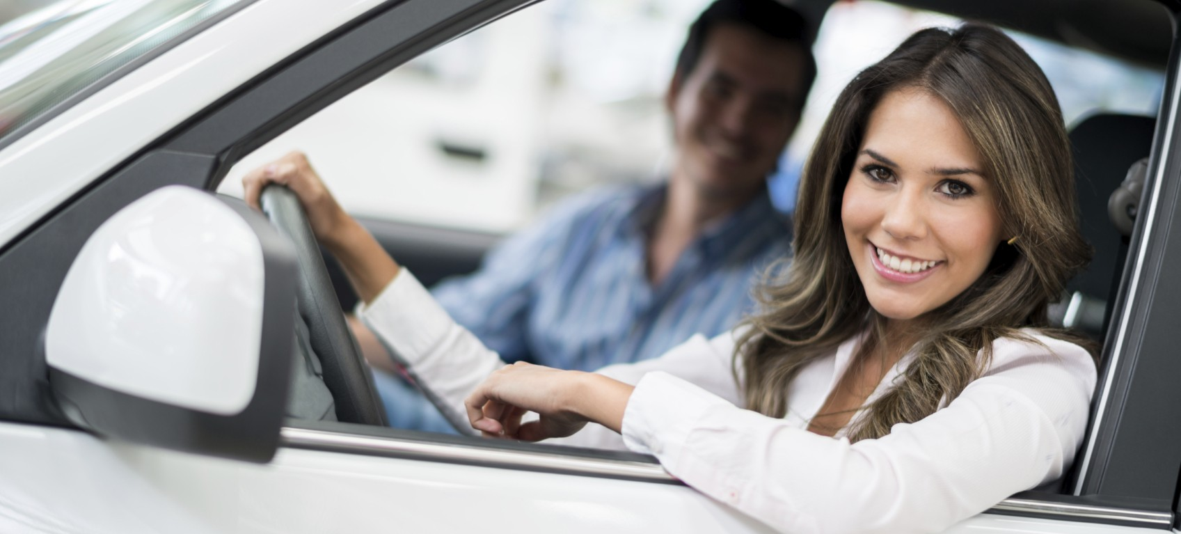 Photo of couple commuting to work in car