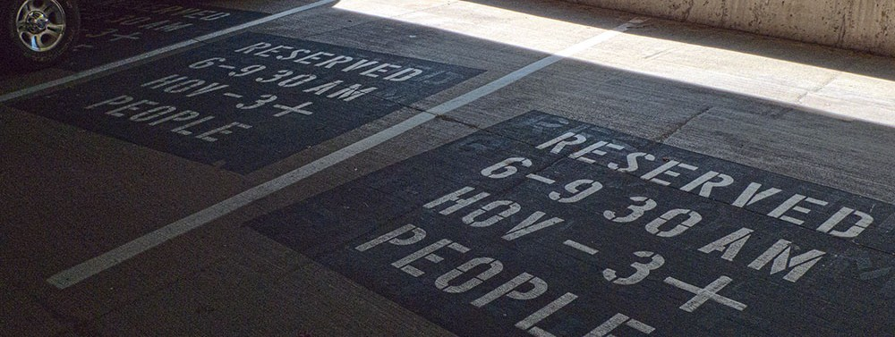 stenciled markings on reserved HOV parking spaces