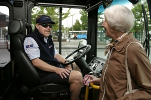 TriMet bus driver and passenger boarding