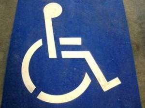 parking spot painted with wheelchair logo